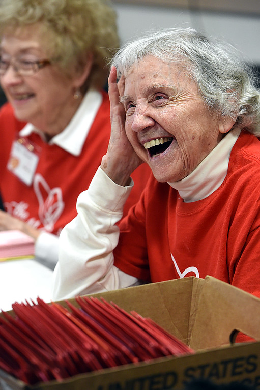 . Norma Nemeth, 96, laughs with other volunteers Monday, Feb. 4, 2019, during first day of stamping for the 2019 Loveland Valentine Remailing Program at the Loveland Chamber of Commerce in east Loveland. Nemeth is the oldest volunteer valentine stamper of the goup.    (Photo by Jenny Sparks/Loveland Reporter-Herald)