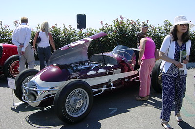 Cheryl, a friend, fellow USC alum, and new owner of an Acura RSX, checks out the interior of one of the vintage race cars (Photo by Valerie)