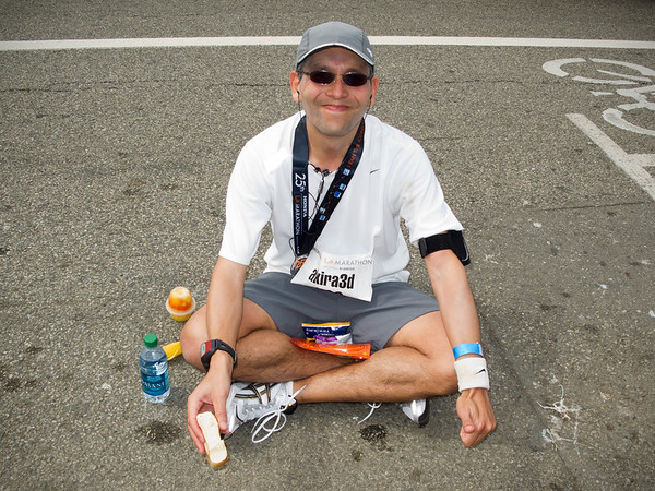 After finishing, Eric sits down to enjoy a few of his post-race spoils