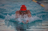 Codi Saunders swimming the breast stroke against Santana