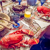 Our heavy-laden table of surf 'n turf, libation and salad