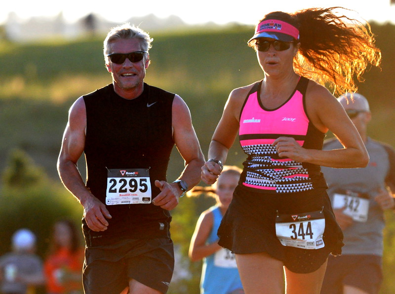 Runners round one of the final stretches of the Valley 5000 5K on Friday Aug. 19, 2017 at Mehaffey Park. (Cris Tiller / Loveland Reporter-Herald)