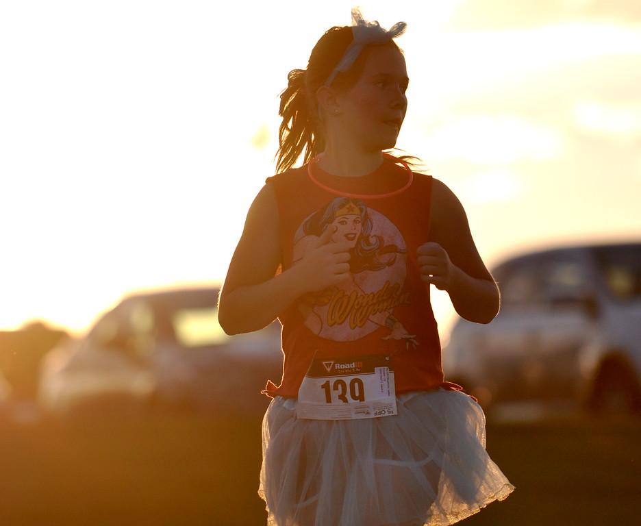 A Loveland girl eyes the finish line of the Valley 5000 5K on Friday Aug. 19, 2017 at Mehaffey Park. (Cris Tiller / Loveland Reporter-Herald)