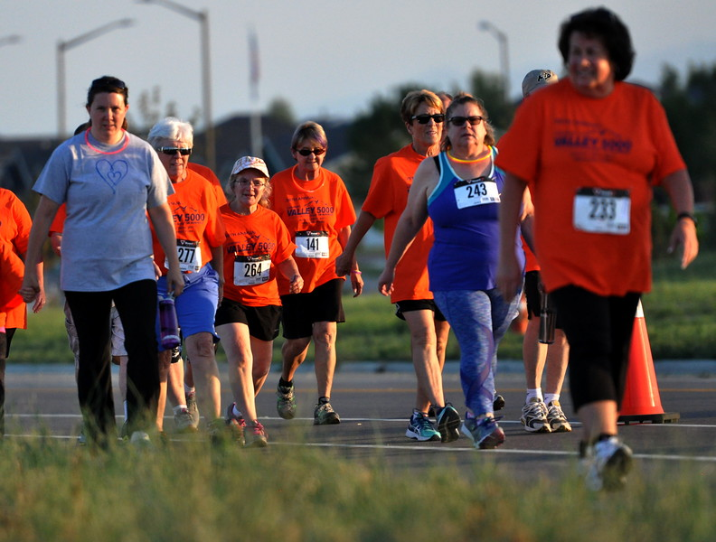 Some participants of the Valley 5000 5K chose to walk the course Friday Aug. 19, 2017 at Mehaffey Park. (Cris Tiller / Loveland Reporter-Herald)