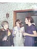 Shari Colvin, Janet Smith, & Val at the Smith's house -- looks like eggnog (Christmas, 1965?)