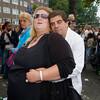Nederland, Amsterdam, 11 september 2005<br /> Amsterdam Noord<br /> Banne Bruist festival 2005<br /> multicultureel stel staat verstrengeld op straat.<br /> zeer corpulente vrouw<br /> foto: Katrien Mulder