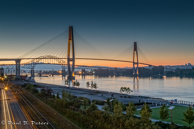 New Westminster, BC - the sky train bridge crossing of the Fraser River at sunrise