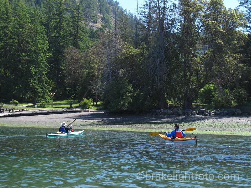 Kayaks approaching Saturna Beach, Thompson Park