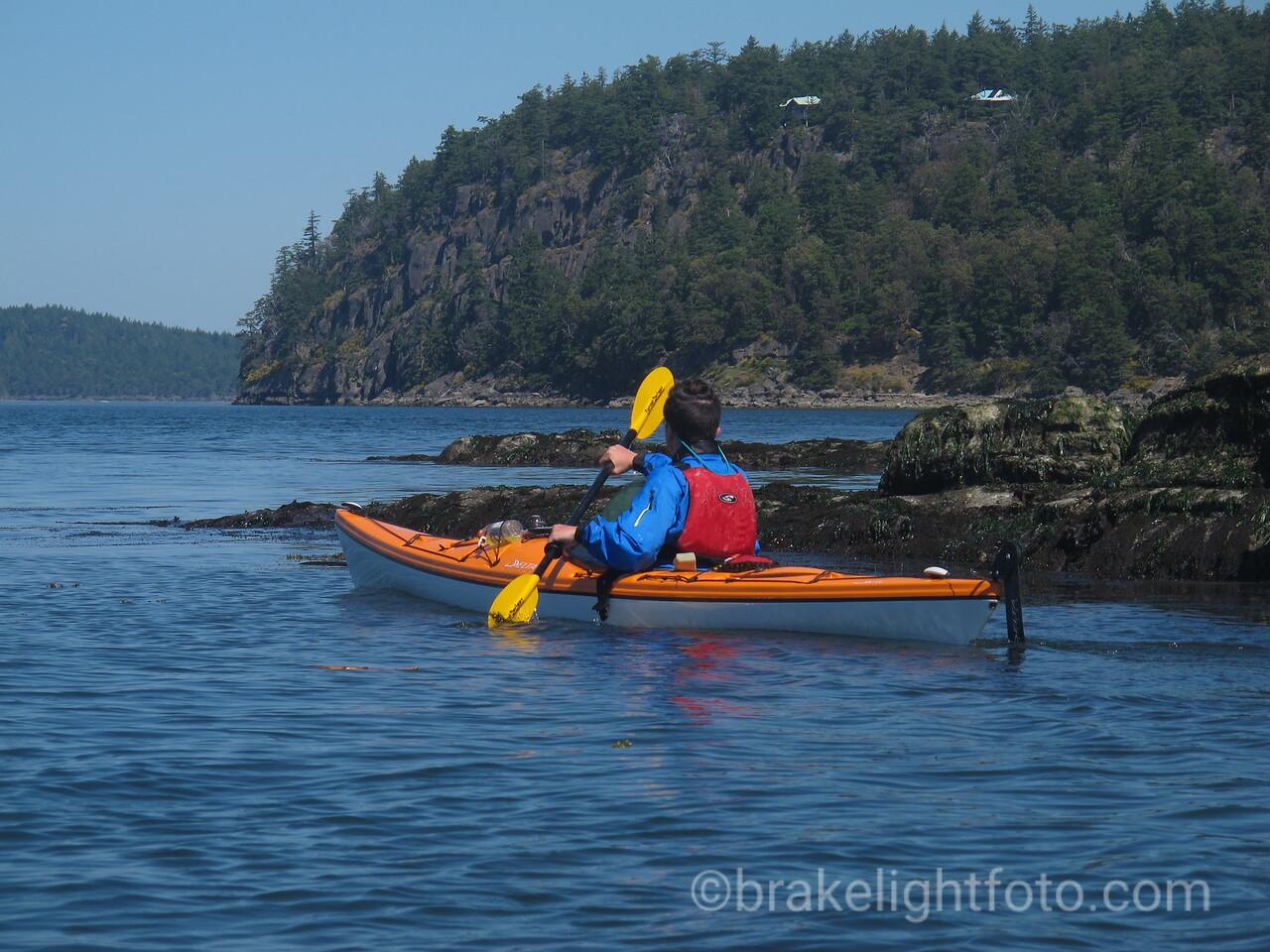 Sea Kayaker approaching Breezy Bay