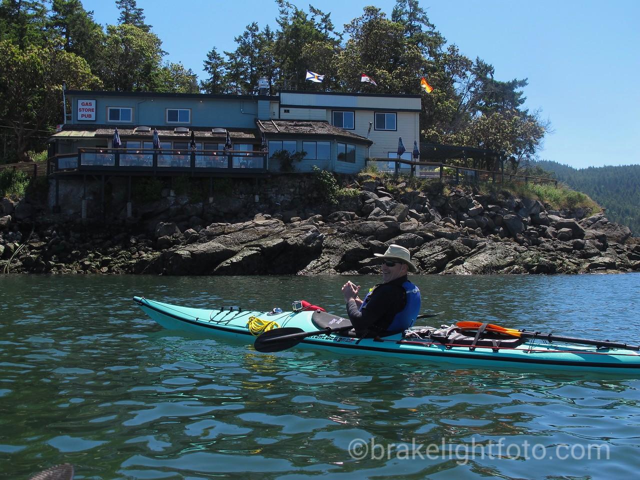 Kayaking past Saturna Lighthouse Pub