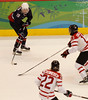 YVR0 20100225 VANCOUVER, BC, CANADA : Team USA's Gigi Marvin handles the puck against Canada in the gold medal women's hockey game at the Vancouver 2010 Olympic Winter games in Vancouver, Canada at the Canada Hockey Place on Thursday, 25 February, 2010. Canada won the game 2-0.