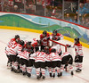 YVR0 20100225 VANCOUVER, BC, CANADA : Canada players huddle before their game against the USA in the gold medal women's hockey game at the Vancouver 2010 Olympic Winter games in Vancouver, Canada at the Canada Hockey Place on Thursday, 25 February, 2010. Canada won the game 2-0.