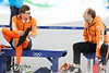 YVR0 20100226 VANCOUVER, BC, CANADA : Sven Kramer (L) of the Netherlands sits with his coach Gerard Kemkers before the semi-finals of the men's team pursuit speed skating race at the Vancouver 2010 Olympic Winter games in Vancouver, Canada at the Richmond Olympic Oval on Friday, 26 February, 2010.