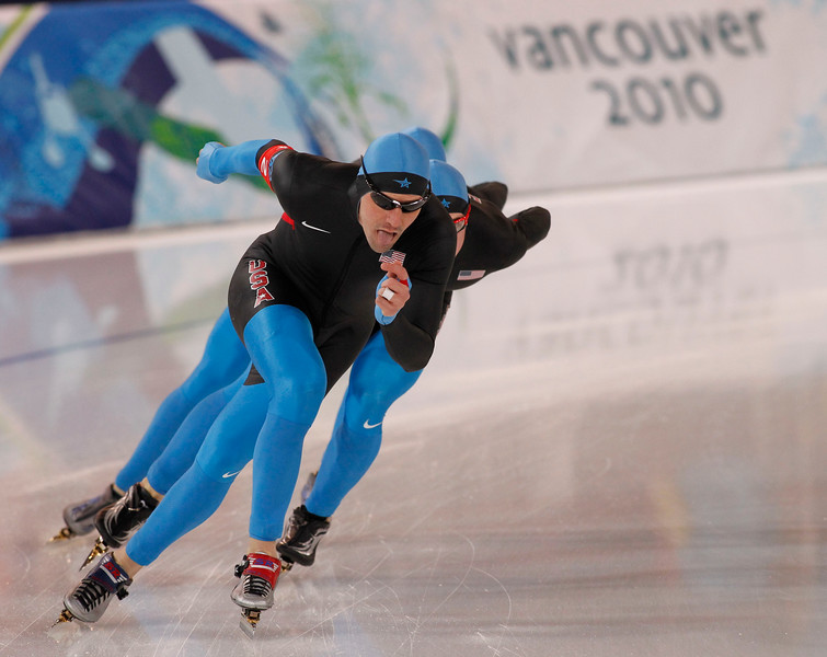 YVR0 20100227 VANCOUVER, BC, CANADA : American Chad Hedrick (front), leads his teamamtes Jonathan Kuck, and Brian Hansen to win the silver medal in the men's speed skating team pursuit at the Vancouver 2010 Olympic Winter games in Vancouver, Canada at the Richmond Olympic Oval on Saturday, 27 February, 2010.