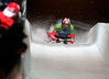YWS0 20100219 WHISTLER, BC, CANADA : Adam Pengilly of Great Britan, finishes his final run in the men's skeleton, at the Vancouver 2010 Olympic Winter games in Vancouver, Canada at The Whistler Sliding Center on Friday, 19 February, 2010. Pengilly finished 18th overall in the competition.