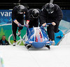 YWS0 20100224 WHISTLER, BC, CANADA : John Napier of the USA(far right), pushes USA-2 with his sledmates during four-man bobsled practice at the Vancouver 2010 Olympic Winter games at the Whistler Sliding Center in Whistler, Canada on Wednesday, 24 February, 2010.
