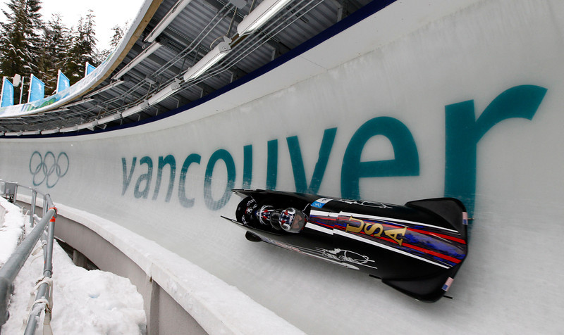 YWS0 20100224 WHISTLER, BC, CANADA : John Napier of the USA(far right), pilots USA-2 with his sledmates through turn 11 during four-man bobsled practice at the Vancouver 2010 Olympic Winter games at the Whistler Sliding Center in Whistler, Canada on Wednesday, 24 February, 2010.