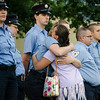 A mourner thanks first responders following a vigil for Vanessa Marcotte on Tuesday evening. Worcester County District Attorney Joseph Early Jr. confirmed during a press conference on Monday that the body of missing jogger and former Leominster resident Marcotte, 27, had been found in Princeton and that her death is being investigated as a homicide. SENTINEL & ENTERPRISE / Ashley Green