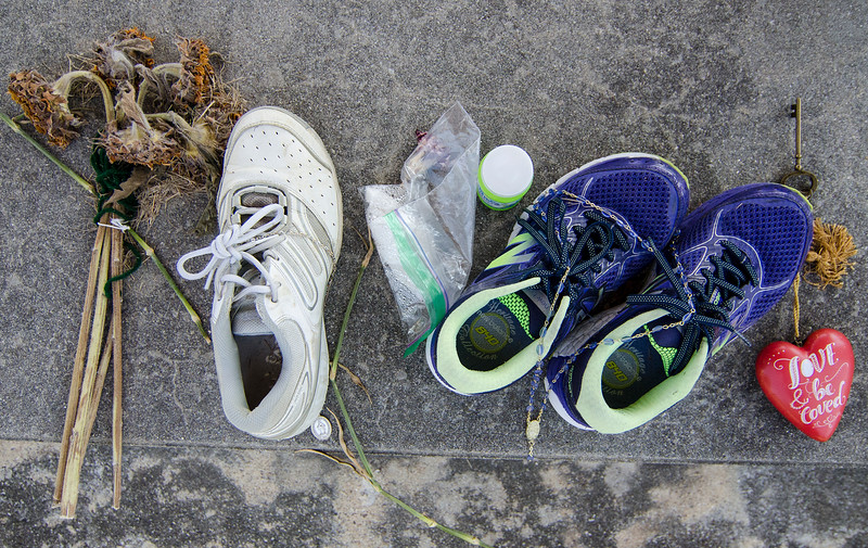 Wilted flowers and running sneakers remain as a small memorial at the gazebo on the Princeton Common after the August 7th murder of Vanessa Marcotte . SENTINEL & ENTERPRISE / Ashley Green