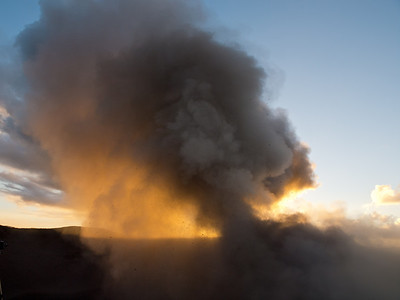 Mt Yasur in sunset.  Note the flying chunks of lava.