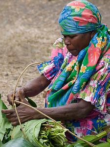 Woman selling fresh produce.