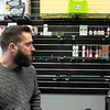 Lineage Vapors Manager Sean McGonagle looks over his shelves with vape products on them now that the ban is over at the shop in Lunenburg. SENTINEL & ENTERPRISE/JOHN LOVE