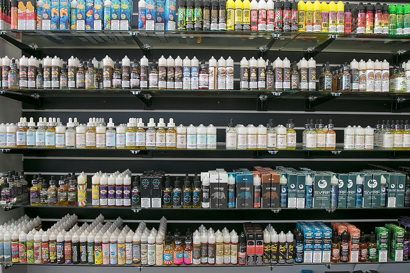 With a federal flavor ban on vaping products looming overhead, businesses like Lineage Vapors, which has several locations in MA and NH, will be significantly impacted. Their shelves of e-liquids in their shop in Lunenburg. SENTINEL & ENTERPRISE/JOHN LOVE