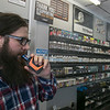 With a federal flavor ban on vaping products looming overhead, businesses like Lineage Vapors, which has several locations in MA and NH, will be significantly impacted.  Employee Jared Grimson does some vaping in their shop in Lunenburg on Friday, September 20, 2019. SENTINEL & ENTERPRISE/JOHN LOVE