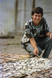 "Richard examines drying fish in ""Bulu"" near Brondong"