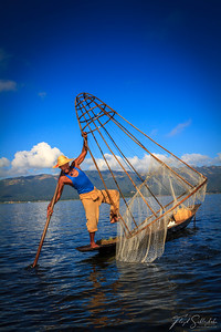 A Leg-Rowing Fisherman Prepares to Throw his Net into Inle Lake