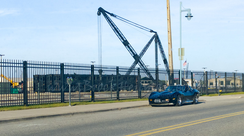 I'm told the Soo Locks are in this photo of a black Corvette