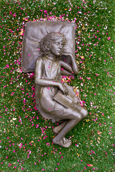 bronze girl with blossoms