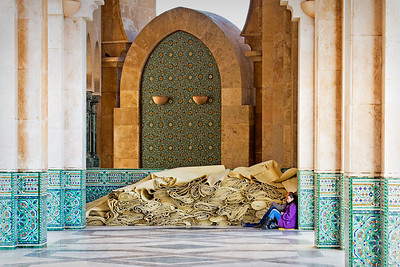 Resting in the shade of the Hassan II Mosque (second largest in the world) in Casablanca, Morocco. Nov, 2011.