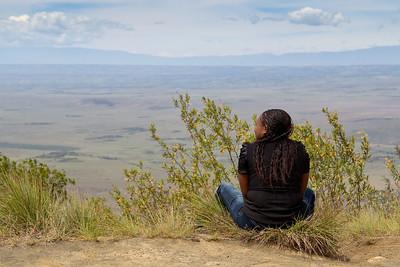 Kenyan girl enjoying the view from the top of Mount Longonot, Kenya. Sept 2011