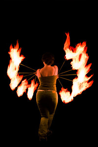 Fire Dancer at Dandelion Cafe in downtown Orlando, Florida.