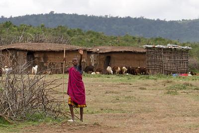 Massai boy standing by his village in the Rift Valley near Nairobi, Kenya. Sept 2011