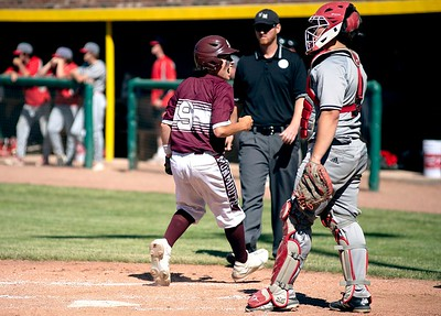 Kyle Palleschi of Monmouth Academy crosses the plate to put the Mustangs up 4-0 during the fourth inning of the Class C South regional final against Lisbon High School in Standish on Thursday.