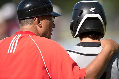 Lisbon High School head coach Randy Ridley talks with Aidan Parker during a time out Thursday in Standish.