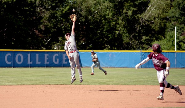 A Monmouth Academy line drive is out of reach for Lisbon High School shortstop Nick Ferrence during the fourth inning of the Class C South regional final in Standish on Thursday. Hayden Fletcher, right, of Monmouth Academy scored on the play to put the mustangs up 5-0.