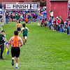 BELFAST, ME - OCTOBER 23: Class boys runners head to finish line during cross country North regionals Saturday October 23, 2021 in Belfast. (Staff photo by Joe Phelan/Staff Photographer)