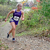 """BELFAST, ME - OCTOBER 23: Second place finisher Waterville's Abby Williams runs up a hill in """"Gollywhoppers"""" section of course during girls Class B cross country North regionals Saturday October 23, 2021 in Belfast. (Staff photo by Joe Phelan/Staff Photographer)"""