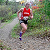 """BELFAST, ME - OCTOBER 23: Cony's Emma Brown runs up a hill in """"Gollywhoppers"""" section of course during girls Class B cross country North regionals Saturday October 23, 2021 in Belfast. (Staff photo by Joe Phelan/Staff Photographer)"""