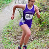 """BELFAST, ME - OCTOBER 23: Waterville's Keya Amundsen runs up a hill in """"Gollywhoppers"""" section of course during girls Class B cross country North regionals Saturday October 23, 2021 in Belfast. (Staff photo by Joe Phelan/Staff Photographer)"""