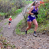 """BELFAST, ME - OCTOBER 23: Waterville's Annmarie Limberger runs up a hill in """"Gollywhoppers"""" section of course during girls Class B cross country North regionals Saturday October 23, 2021 in Belfast. (Staff photo by Joe Phelan/Staff Photographer)"""