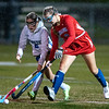Lewiston's Alyssa Tremblay, left and Messalonskee's Payton Alexander battle for the ball during the first half of Tuesday's field hockey playoff game in Lewiston. Photo by Russ Dillingham/Sun Journal