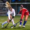 Messalonskee's Francesca Caccamo, right defends against Lewiston's Allison Lavallee during the first half of Tuesday's field hockey playoff game in Lewiston. Photo by Russ Dillingham/Sun Journal