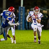 FAIRFIELD, ME - OCTOBER 22:  Messalonskee quarterback Brady Doucette, 7, right, runs the ball as teammate Jack Kinney blocks Lawrence Lawrence defensive back Noah Grass   during a football game Friday October 22, 2021 on Keyes Field at Lawrence High School in Fairfield. (Staff photo by Joe Phelan/Staff Photographer)