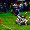 FAIRFIELD, ME - OCTOBER 22: Lawrence running back Parker Higgins top, flies over Messalonskee defensive back Garrett Card to score a running touchdown during a football game Friday October 22, 2021 on Keyes Field at Lawrence High School in Fairfield. (Staff photo by Joe Phelan/Staff Photographer)