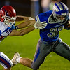 FAIRFIELD, ME - OCTOBER 22: Messalonskee defensive back Bryce Crowell, left, tries to stop Lawrence running back Parker Higgins during a football game Friday October 22, 2021 on Keyes Field at Lawrence High School in Fairfield. (Staff photo by Joe Phelan/Staff Photographer)