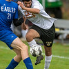 CHINA, ME - OCTOBER 26: Erskine Academy's Chase Larrabee, left, plays defense on Cape Elizabeth's Hamza Shir during a Class B South soccer quarterfinal game Tuesday October 26, 2021 at Erskine Academy in China. (Staff photo by Joe Phelan/Staff Photographer)